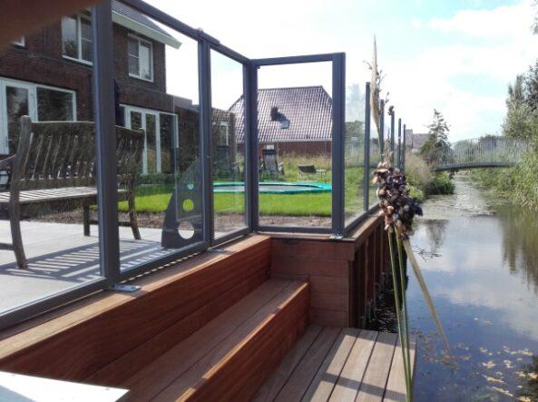 terrasscherm langs het water